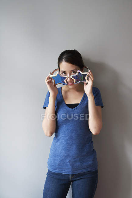 Young woman having fun with her fun glasses — Stock Photo