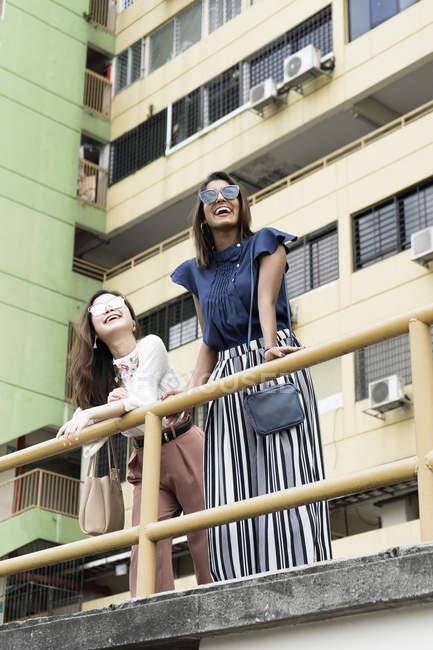 Young casual asian girls posing at camera — Stock Photo