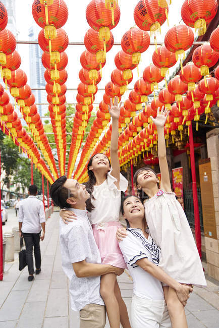 Young happy asian family at buddhism holiday — Stock Photo