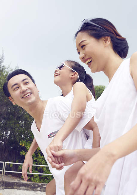 Happy asian family spending time together on beach — Stock Photo