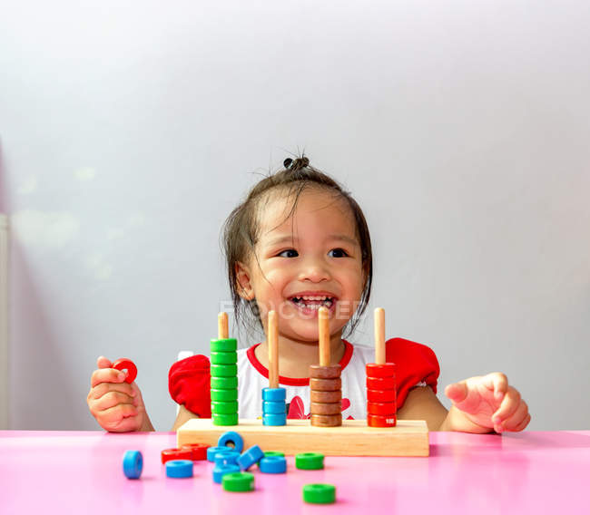 Toddler playing an educational game. — Stock Photo
