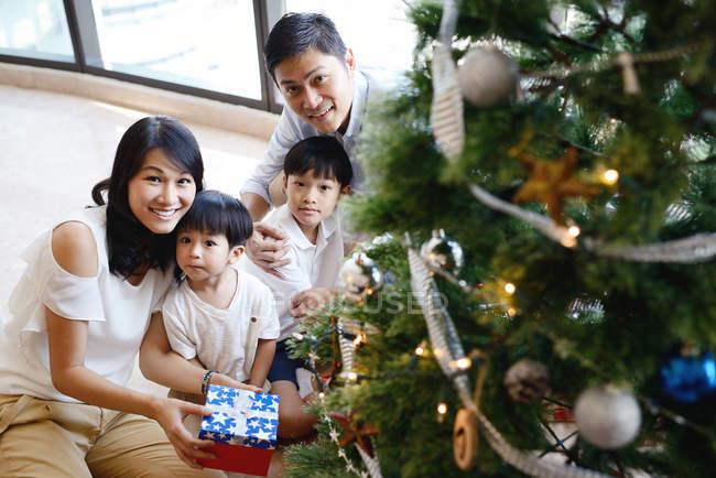 Asian family celebrating Christmas holiday — Stock Photo