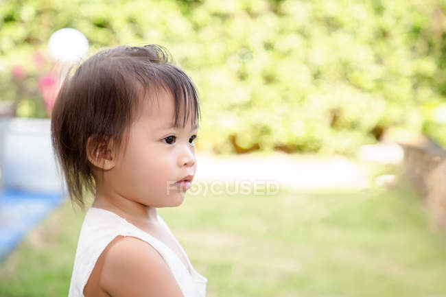 Innocent little girl looking away. — Stock Photo