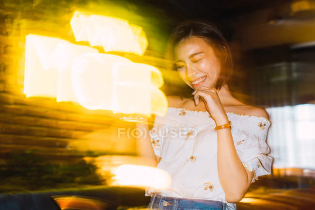 Young asian woman in comfortable bar — Stock Photo