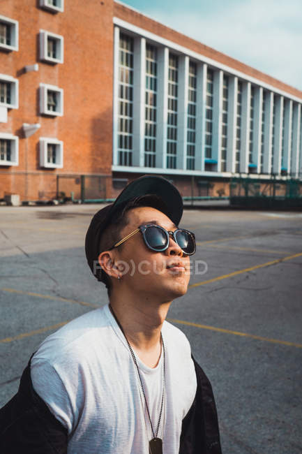 Portrait of cool young asian man in sunglasses — Stock Photo