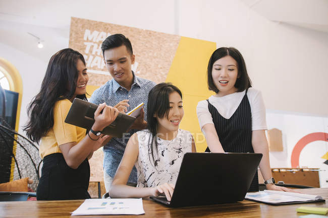 Young asian people in creative modern office — Stock Photo