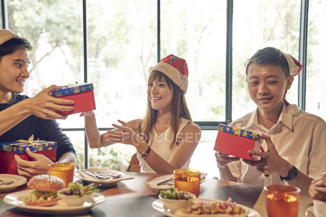 Company of young asian friends together celebrating christmas — Stock Photo