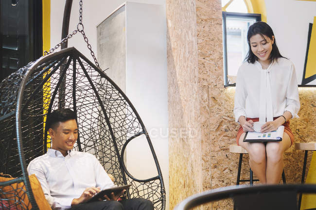Young asian workers in creative modern office — Stock Photo