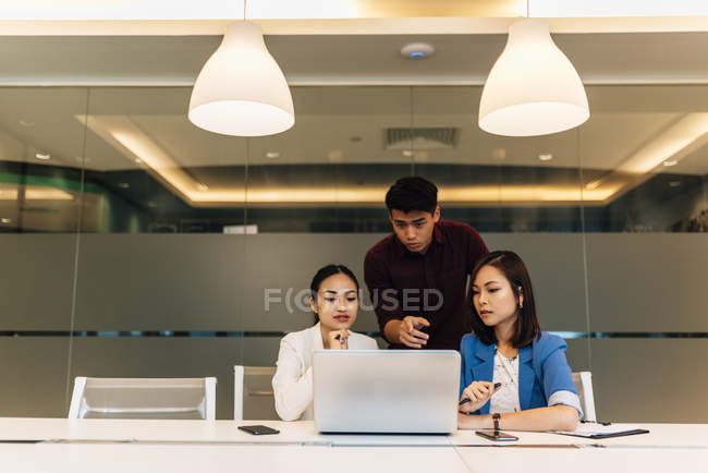 Asian business coworkers working together in the office — Stock Photo