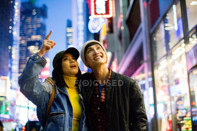 Young asian couple in time square — Stock Photo