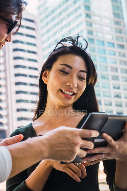 Young asian couple sharing tablet together — Stock Photo