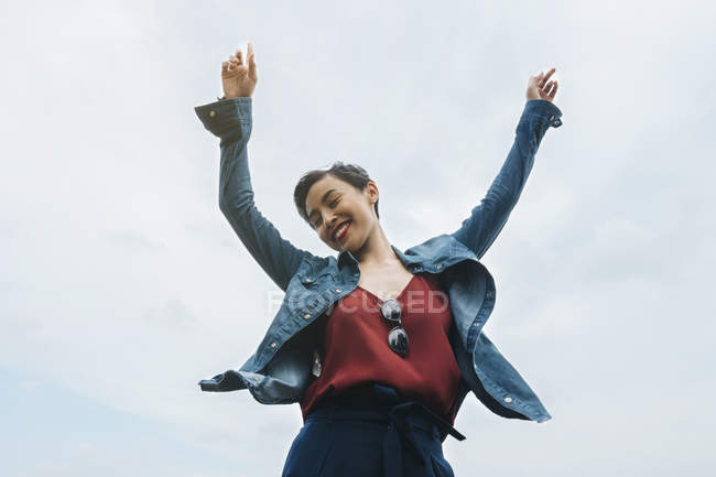 Young Malay lady in Singapore enjoying herself outdoors with natural lighting. — Stock Photo