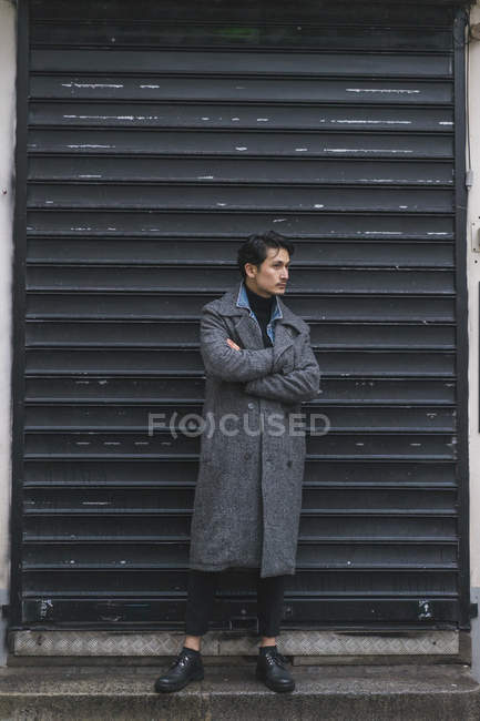 Young attractive casual asian man with arms crossed — Stock Photo