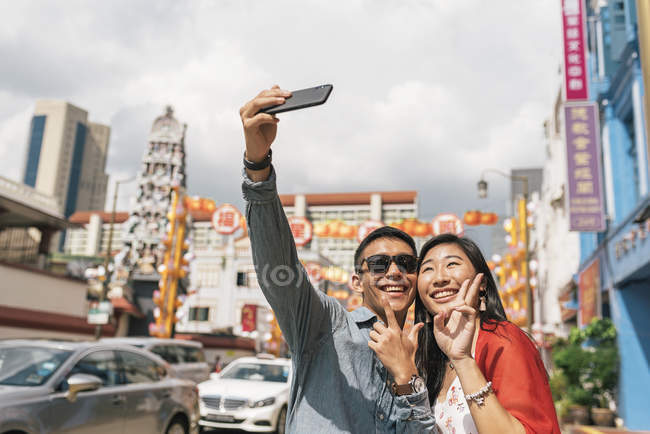 Young asian couple spending time together and taking selfie — Stock Photo