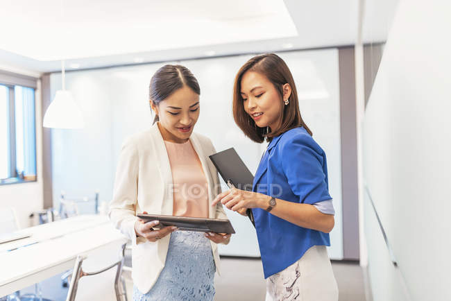 Young attractive asian women working in office — Stock Photo
