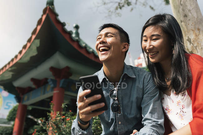 Asian Chinese Couple using cellphone at Chinatown — Stock Photo