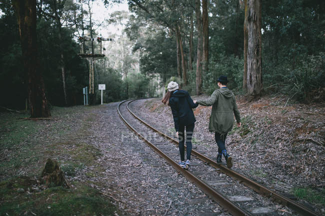 Young couple exploring the railway track — Stock Photo