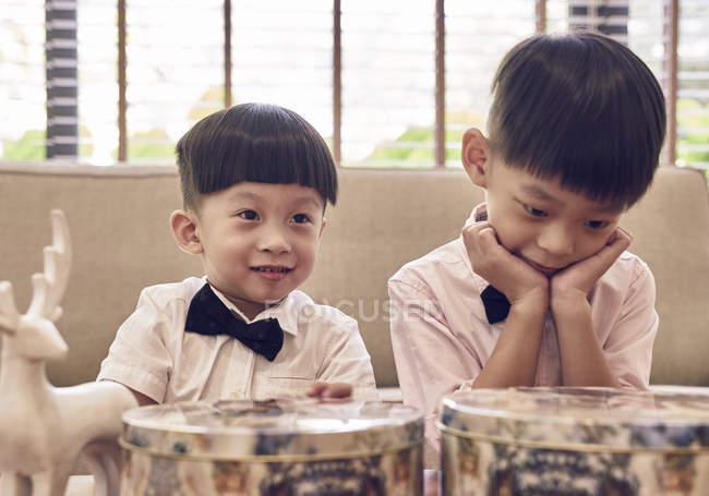 Happy asian boys celebrating christmas together — Stock Photo