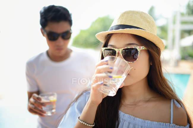 Young asian couple drinking cocktails in cafe together — Stock Photo