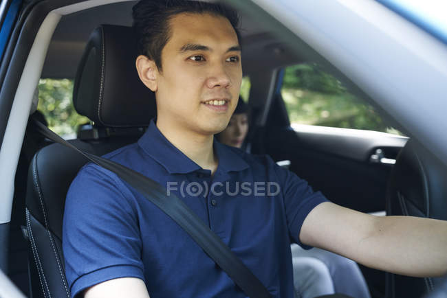 Young asian man driver in the car — Stock Photo
