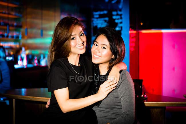 Good girlfriends having a fun at night club — Stock Photo