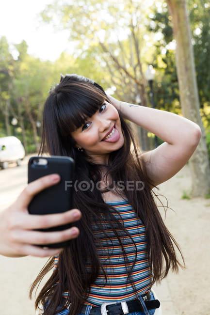 Young Eurasian woman taking a selfie in Barcelona — Stock Photo