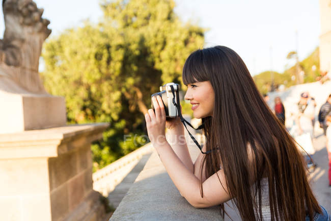 Eurasian woman taking a photo in Barcelona — Stock Photo