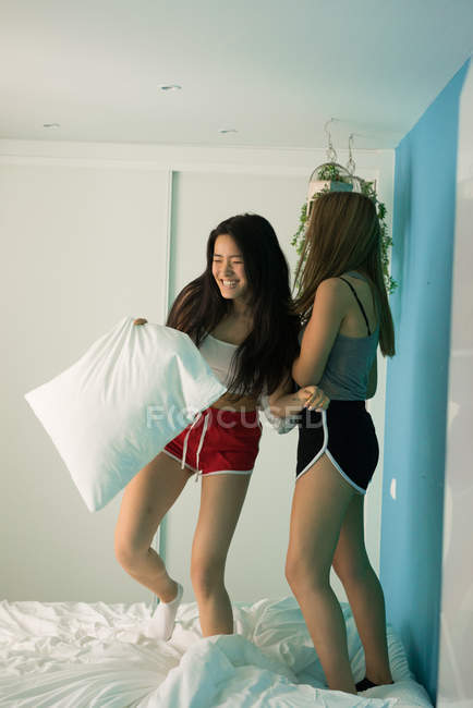 Two young women at home having fun — Stock Photo