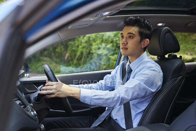 Young asian male driver in the car — Stock Photo