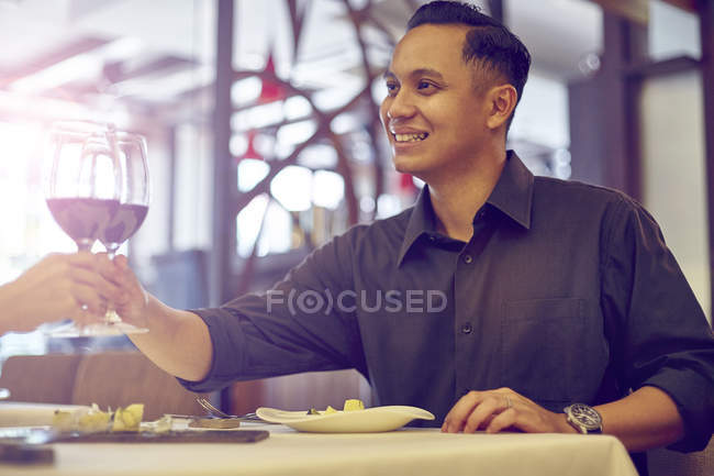 Young asian handsome man in cafe with wine at date — Stock Photo