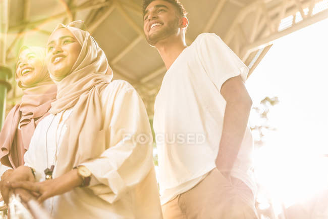 Young muslim group smiling on MRT staircase gazing — Stock Photo