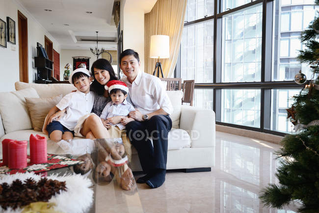 Happy asian family celebrating Christmas together at home — Stock Photo