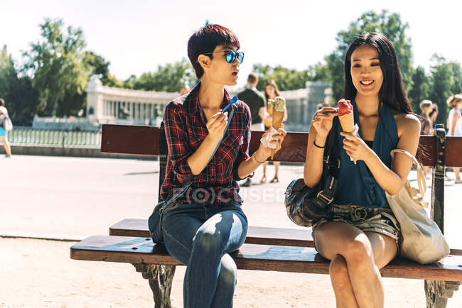 Asian Women Enjoying Their Ice Cream On A Hot Day Carefree Resting Stock Photo 214312362