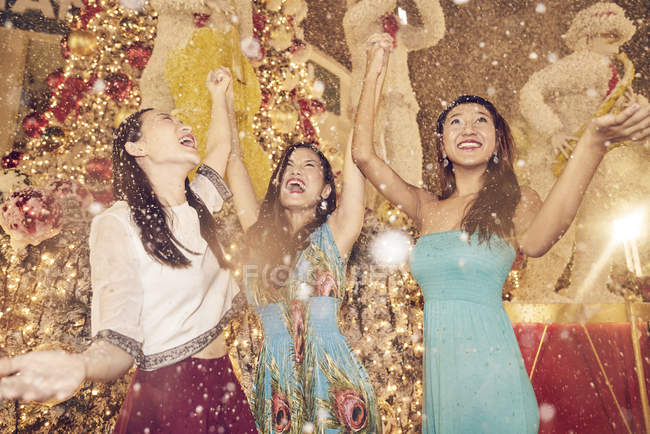 Young attractive asian women at christmas shopping — Stock Photo