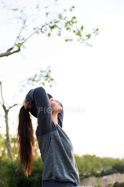 Young beautiful asian woman with arms raised — Stock Photo