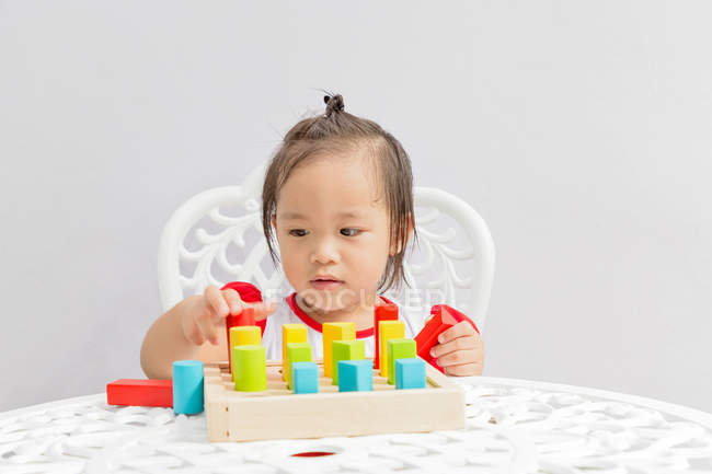 Young little asian toddler girl playing with educational toys — Stock Photo