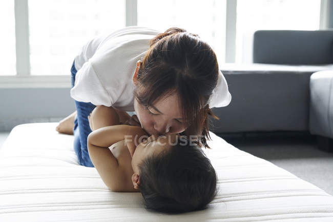 Mother changing diapers for her adorable baby boy — Stock Photo