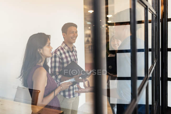 Young asian people at meeting in modern office — Stock Photo