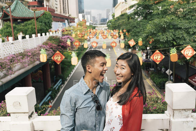 Young happy asian couple spending time in Chinatown — Stock Photo