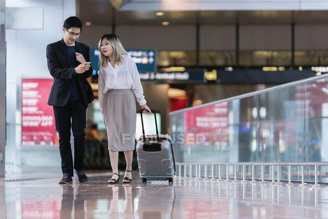 Successful business asian couple together in airport — Stock Photo