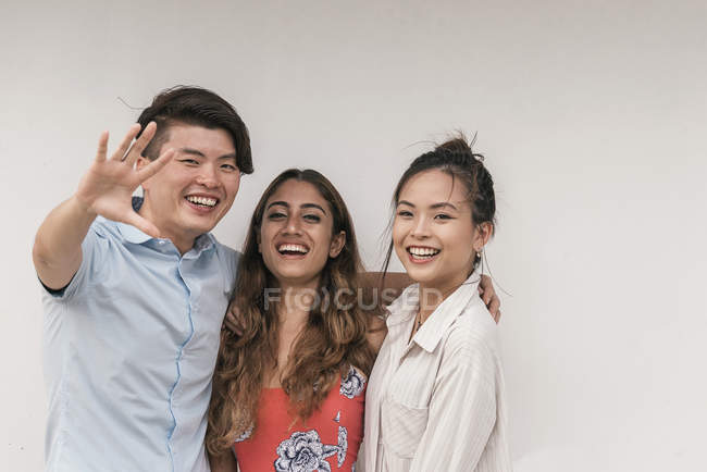 Group of young asian friends posing to camera — Stock Photo