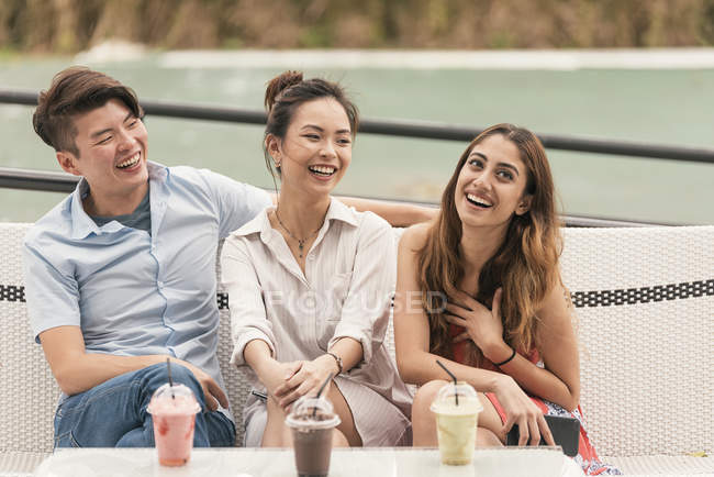 Group of young asian friends together in restaurant with drink — Stock Photo