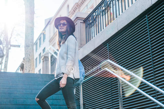 Young attractive asian woman posing on stairs — Stock Photo