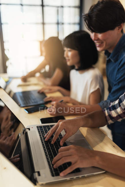 Young asian business people working together in modern office — Stock Photo