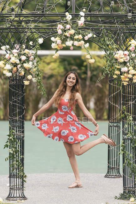 Young beautiful indian woman in dress posing to camera — Stock Photo