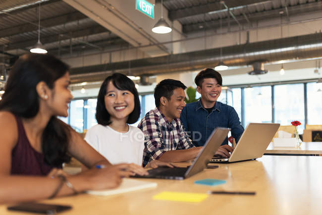 Young successful business people working together in modern office — Stock Photo