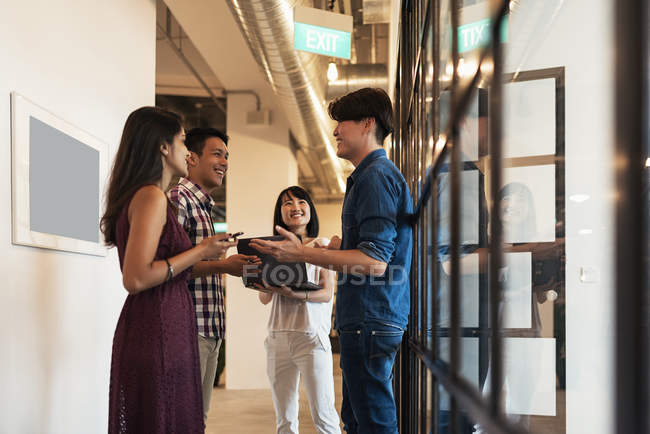 Young asian people at work with in modern office — Stock Photo