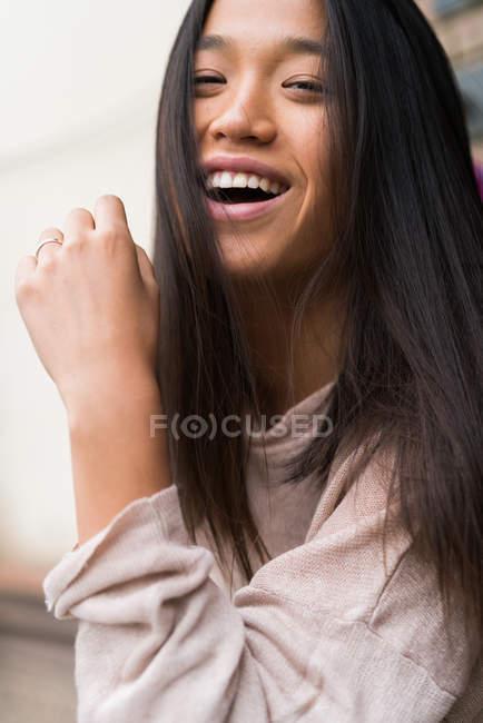 Young Chinese woman looking at the camera — Stock Photo