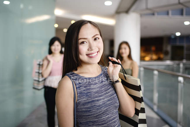 Young asian attractive women with shopping bags — Stock Photo
