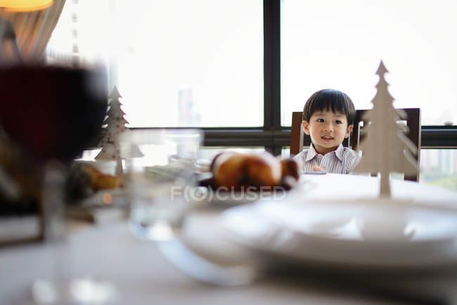 Happy asian boy celebrating Christmas at home — Stock Photo